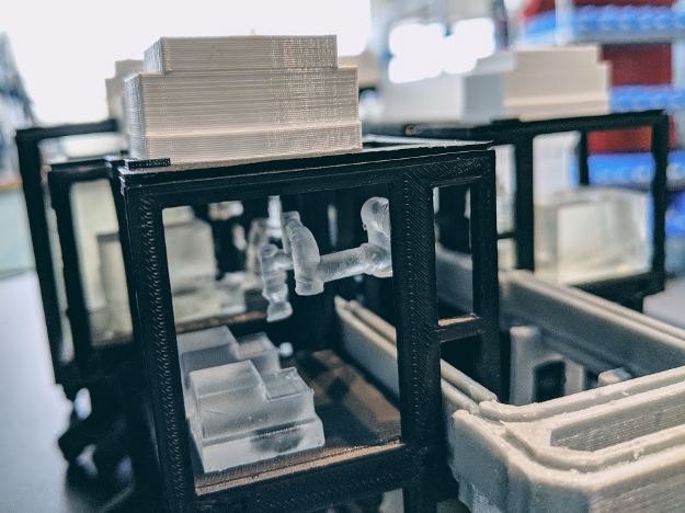A set of 3D printed model Reconfigurable Automation Carts allow scientists and engineers to prototype new lab automation system layouts.