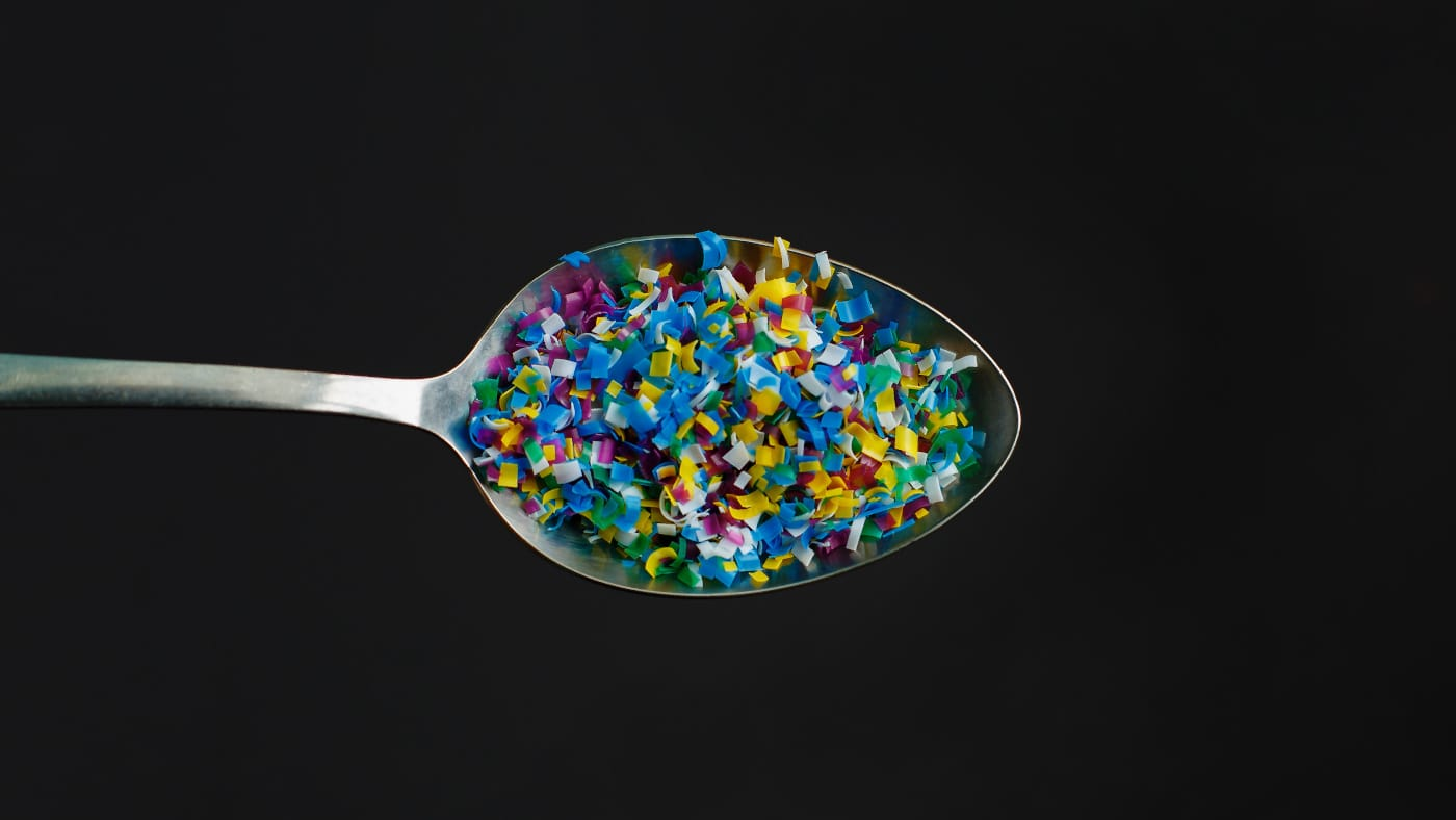 Image showing plastic pieces on a metal spoon