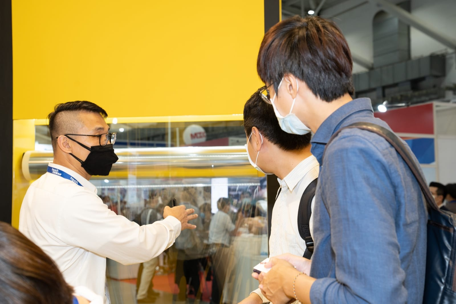 Parker Chen of Zymergen's Taiwan business development team shows two Touch Taiwan conferees our 1.3 m wide, 1 km long roll of Hyaline Z2