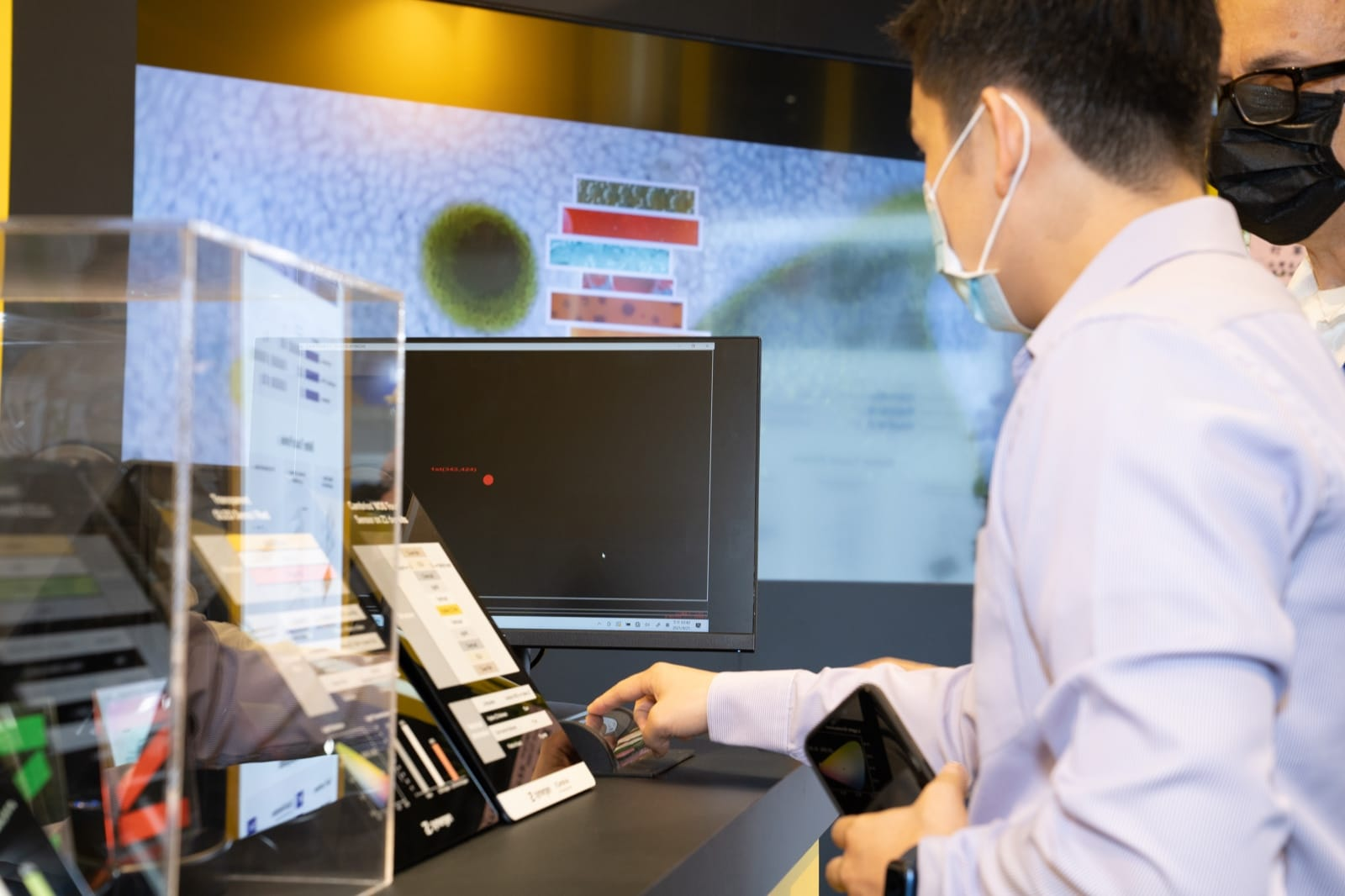 A visitor interacts with a prototype Hyaline touch sensor display.